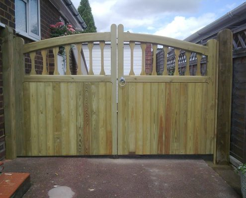 pair of heavy framed curved top windsor gates