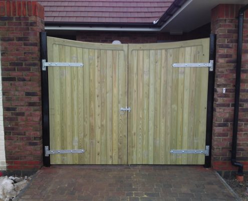 pair of heavy framed scalloped top tongue and groove gates